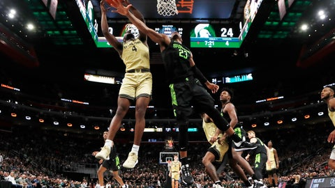 <p>               Michigan State forward Xavier Tillman (23) deflects a shot by Oakland forward Daniel Oladapo (4) during the first half of an NCAA college basketball game, Saturday, Dec. 14, 2019, in Detroit. (AP Photo/Carlos Osorio)             </p>