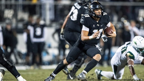 <p>               Central Florida quarterback Dillon Gabriel (11) runs out of the pocket during the second half of the team's NCAA college football game against South Florida, Friday, Nov. 29, 2019, in Orlando, Fla. (AP Photo/Willie J. Allen Jr.)             </p>