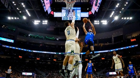 <p>               Orlando Magic's Michael Carter-Williams shoots past Milwaukee Bucks' Brook Lopez during the first half of an NBA basketball game Monday, Dec. 9, 2019, in Milwaukee. (AP Photo/Morry Gash)             </p>