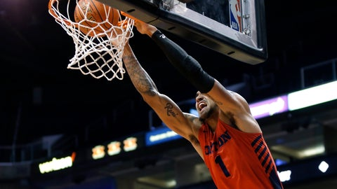 <p>               Dayton forward Obi Toppin dunks the ball against Saint Mary's during the first half of an NCAA college basketball game, Sunday, Dec. 8, 2019, in Phoenix. (AP Photo/Ralph Freso)             </p>