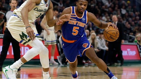<p>               New York Knicks' Dennis Smith Jr. (5) drives against Milwaukee Bucks' Giannis during the first half of an NBA basketball game Monday, Dec. 2, 2019, in Milwaukee. (AP Photo/Jeffrey Phelps)             </p>