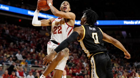 <p>               Iowa State guard Tyrese Haliburton (22) drives to the basket over Southern Mississippi guard Gabe Watson, right, during the first half of an NCAA college basketball game, Tuesday, Nov. 19, 2019, in Ames, Iowa. (AP Photo/Charlie Neibergall)             </p>