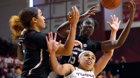 <p>               Temple's Mia Davis (25) battles for position against South Carolina's Breanna Beal, left, and Laeticia Amihere during the second half of an NCAA college basketball game, Saturday, Dec. 7, 2019, in Philadelphia. (AP Photo/Derik Hamilton)             </p>