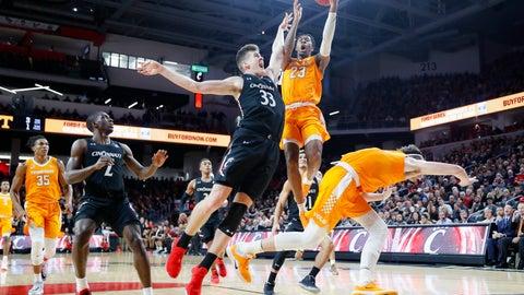 <p>               Tennessee's Jordan Bowden (23) shoots against Cincinnati's Chris Vogt (33) during the second half of an NCAA college basketball game, Wednesday, Dec. 18, 2019, in Cincinnati. (AP Photo/John Minchillo)             </p>