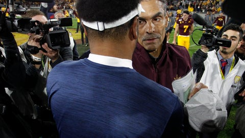 <p>               Arizona State head coach Herm Edwards meets Arizona coach Kevin Sumlin at the center of the field after his team defeated Arizona 24-14 in an NCAA college football game, Saturday, Nov. 30, 2019, in Tempe, Ariz. (AP Photo/Darryl Webb)             </p>