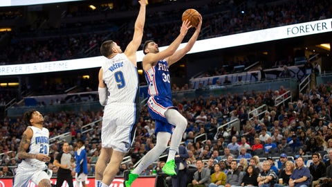 <p>               Philadelphia 76ers guard Furkan Korkmaz (30) attempts to lay up the ball against Orlando Magic center Nikola Vucevic (9) during the first half of an NBA basketball game in Orlando, Fla., Friday, Dec. 27, 2019. (AP Photo/Willie J. Allen Jr.)             </p>