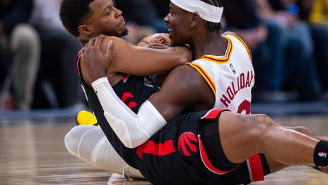 <p>               Indiana Pacers guard Aaron Holiday (3), right, and Toronto Raptors guard Kyle Lowry (7) battle for the ball during an NBA basketball game, Monday, Dec. 23, 2019, in Indianapolis. (AP Photo/Doug McSchooler)             </p>