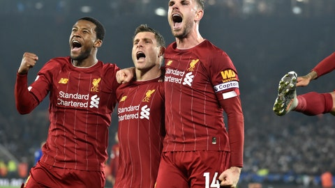 <p>               Liverpool's James Milner, second left, celebrates with his teammate Liverpool's Georginio Wijnaldum, left, and Liverpool's Jordan Henderson after scoring his side's second goal during the English Premier League soccer match between Leicester City and Liverpool at the King Power Stadium in Leicester, England, Thursday, Dec. 26, 2019. (AP Photo/Rui Vieira)             </p>