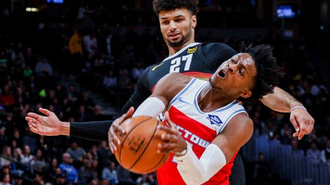 <p>               Sacramento Kings guard De'Aaron Fox (5) collides with Denver Nuggets guard Jamal Murray (27) in the first half of an NBA basketball game Sunday, Dec. 29, 2019, in Denver. (AP Photo/Joe Mahoney)             </p>