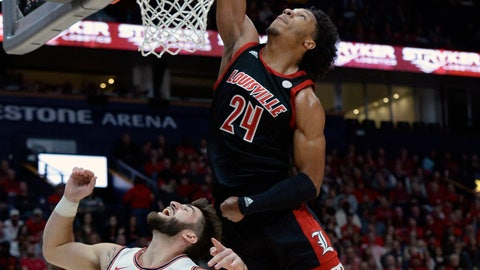 <p>               Louisville forward Dwayne Sutton (24) reaches for a rebound over Western Kentucky guard Camron Justice (5) during the first half of an NCAA college basketball game Friday, Nov. 29, 2019, in Nashville, Tenn. (AP Photo/Mark Zaleski)             </p>