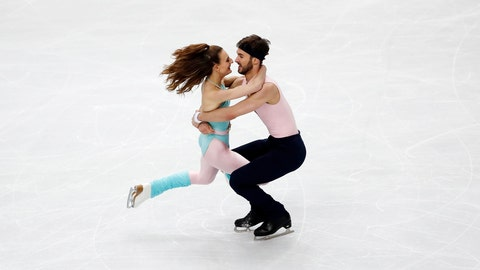 <p>               France's Gabriella Papadakis and Guillaume Cizeron compete in the Ice Dance – Rhythm Dance program during the figure skating Grand Prix finals at the Palavela ice arena, in Turin, Italy, Friday, June 7, 2019. (AP Photo/Antonio Calanni)             </p>