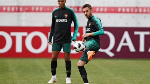 "<p>               FILE - In this Wednesday, June 13, 2018 file photo, Portugal's Bernardo Silva, right, plays the ball next to teammate Joao Mario during the training session in Kratovo, outskirts Moscow, Russia. Portugal midfielder Joao Mario has on Tuesday, Dec. 3, 2019 defended compatriot Bernardo Silva against racism, saying it was ""strange"" the Manchester City playmaker was punished for a tweet to teammate Benjamin Mendy.  (AP Photo/Francisco Seco, file)             </p>"