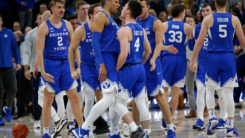 <p>               BYU's Alex Barcello (4) celebrates his three-point basket with teammate Yoeli Childs, center left, in the second half during an NCAA college basketball game against Utah State, Saturday, Dec. 14, 2019, in Salt Lake City. (AP Photo/Rick Bowmer)             </p>