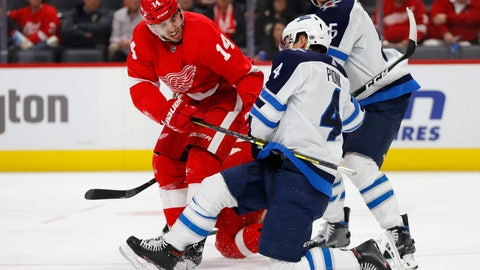 <p>               Detroit Red Wings center Robby Fabbri (14) and Winnipeg Jets defenseman Neal Pionk (4) battle for position in the second period of an NHL hockey game Thursday, Dec. 12, 2019, in Detroit. (AP Photo/Paul Sancya)             </p>