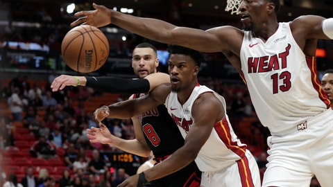 <p>               Chicago Bulls guard Zach LaVine (8), Miami Heat forward Jimmy Butler, center, and center Bam Adebayo (13) go for the ball during the first half of an NBA basketball game, Sunday, Dec. 8, 2019, in Miami. (AP Photo/Lynne Sladky)             </p>