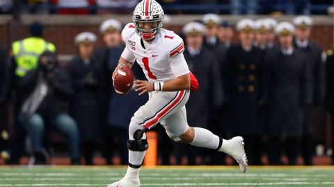 <p>               Ohio State quarterback Justin Fields rolls out to pass against Michigan in the second half of an NCAA college football game in Ann Arbor, Mich., Saturday, Nov. 30, 2019. (AP Photo/Paul Sancya)             </p>