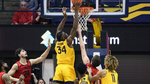<p>               West Virginia forward Oscar Tshiebwe (34) makes a basket as he is defended by Austin Peay center Matheus Silveira (24) during the first half of an NCAA college basketball game Thursday, Dec. 12, 2019, in Morgantown, W.Va. (AP Photo/Kathleen Batten)             </p>