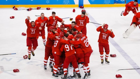 <p>               FILE - In this file photo dated Sunday, Feb. 25, 2018, Olympic athletes from Russia celebrate after winning the men's gold medal hockey game against Germany, 4-3, in overtime at the 2018 Winter Olympics, in Gangneung, South Korea.  Sanctions handed down by the World Anti-Doping Agency on Monday Dec. 9, 2019, mean there won't be a Russian flag or anthem, but athletes are still aiming for the Tokyo Olympics, and the Russian hockey players belted out the Russian national anthem, even without any music. (AP Photo/Jae C. Hong, FILE)             </p>