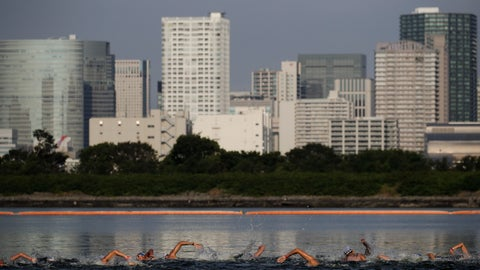 "<p>               FILE - In this Aug. 11, 2019, file photo, athletes compete in a marathon swimming test event at Odaiba Marine Park, a venue for marathon swimming and triathlon at the Tokyo 2020 Olympics, in Tokyo. The IOC moved next year's Tokyo Olympic marathons and race walks out of the Japanese capital to avoid the stifling heat and humidity. Some swimmers and an 11,000-member coaching body want similar treatment: find an alternative to the distance-swimming venue in Tokyo Bay known as the ""Odaiba Marine Park.""(AP Photo/Jae C. Hong, File)             </p>"