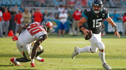 <p>               Jacksonville Jaguars quarterback Gardner Minshew (15) scrambles away from Tampa Bay Buccaneers linebacker Jason Pierre-Paul (90) during the second half of an NFL football game, Sunday Dec. 1, 2019, in Jacksonville, Fla. (AP Photo/Stephen B. Morton)             </p>