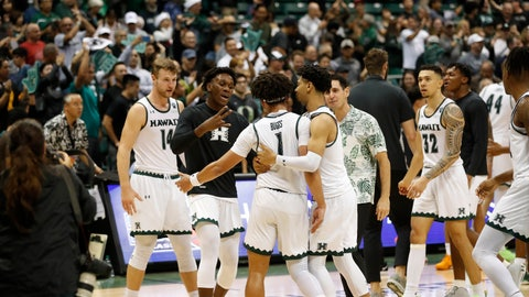 <p>               Hawaii players celebrate after defeating UTEP in an NCAA college basketball game Sunday, Dec. 22, 2019, in Honolulu. Hawaii defeated UTEP 67-63 advancing to the semifinals of the tournament. (AP Photo/Marco Garcia)             </p>