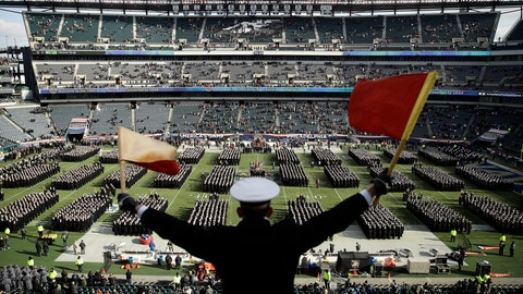 <p>               FILE - In this Dec. 8, 2018, file photo, Navy Midshipman Frey Pankratz singles his classmates as they march onto the field ahead of an NCAA college football against the Army in Philadelphia. The 120th Army-Navy game is set for Saturday in Philadelphia.  Navy leads the series 60-52-7. (AP Photo/Matt Rourke, File)             </p>