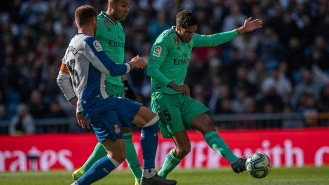 <p>               Real Madrid's Raphael Varane, right, scores during a Spanish La Liga soccer match between Real Madrid and RCD Espanyol at the Santiago Bernabeu stadium in Madrid, Saturday Dec. 7, 2019. (AP Photo/Bernat Armangue)             </p>
