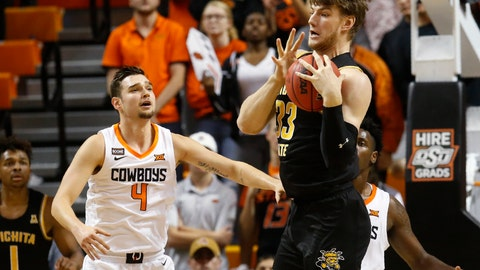 <p>               Wichita State center Asbjorn Midtgaard (33) grabs a rebound in front of Oklahoma State guard Thomas Dziagwa in the first half of an NCAA college basketball game in Stillwater, Okla., Sunday, Dec. 8, 2019. (AP Photo/Sue Ogrocki)             </p>