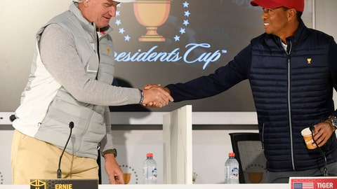 <p>               International captain Ernie Els, left, and USA captain Tiger Woods shake hands during a press conference ahead of the President's Cup Golf tournament in Melbourne, Australia, Tuesday, Dec. 10, 2019. (AP Photo/Andy Brownbill)             </p>