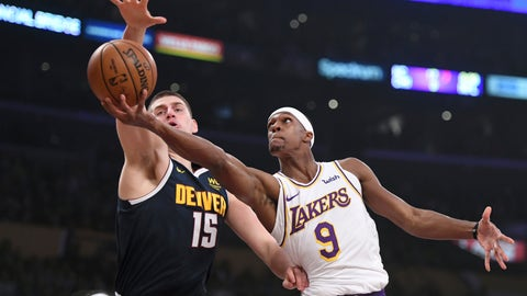 <p>               Los Angeles Lakers guard Rajon Rondo, right, attempts a layup against Denver Nuggets center Nikola Jokic during the first half of an NBA basketball game Sunday, Dec. 22, 2019, in Los Angeles. (AP Photo/Michael Owen Baker)             </p>