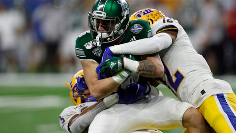 <p>               Eastern Michigan wide receiver Hassan Beydoun is tackled by Pittsburgh defensive backs Damar Hamlin, left, and Paris Ford (12) during the first half of the Quick Lane Bowl NCAA college football game Thursday, Dec. 26, 2019, in Detroit. (AP Photo/Carlos Osorio)             </p>