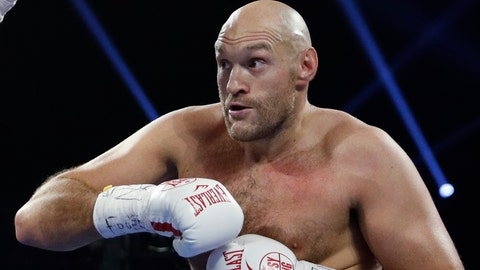 <p>               FILE - In this file photo dated Saturday, June 15, 2019, Tyson Fury, of England in action against Tom Schwarz of Germany, in Las Vegas, USA.  Tyson Fury has changed trainers just two months before his likely heavyweight rematch with WBC champion Deontay Wilder, it is revealed Monday Dec. 16, 2019. (AP Photo/John Locher, FILE)             </p>