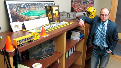 <p>               FILE - In this March 18, 2016, file photo, Fargo attorney Josh Swanson, of the Vogel Law Firm in Fargo, N.D., poses in his office next to a bookcase that contains numerous items of memorabilia from his alma mater North Dakota State University. NDSU seems to have perfected the art of reloading. The Bison are 12-0 and the top seed again in the FCS playoffs despite breaking in a new coach and a new quarterback this season. But with all their winning, seven of the last eight championships, is it all starting to get a little routine in Fargo? (AP Photo/Dave Kolpack, File)             </p>