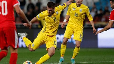 <p>               Ukraine's Artem Besedin scores his side's second goal during the Euro 2020 group B qualifying soccer match between Serbia and Ukraine, on the stadium Rajko Mitic in Belgrade, Serbia, Sunday, Nov. 17, 2019. (AP Photo/Darko Vojinovic)             </p>