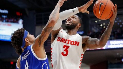 <p>               Dayton's Trey Landers (3) shoots against Drake's Anthony Murphy (4) during the first half of an NCAA college basketball game, Saturday, Dec. 14, 2019, in Dayton, Ohio. (AP Photo/John Minchillo)             </p>