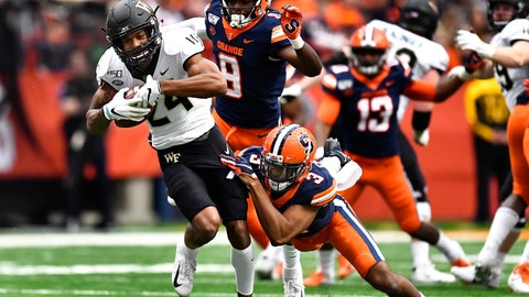 <p>               Wake Forest wide receiver Donavon Greene, left, is tackled by Syracuse defensive back Christopher Fredrick after a reception during the first half of an NCAA college football game in Syracuse, N.Y., Saturday, Nov. 30, 2019. (AP Photo/Adrian Kraus)             </p>
