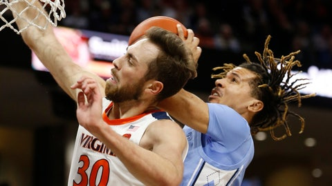<p>               Virginia forward Jay Huff (30) and North Carolina guard Cole Anthony, right, collide under the basket during the first half of an NCAA college basketball game in Richmond, Va., Sunday, Dec. 8, 2019. (AP Photo/Steve Helber)             </p>