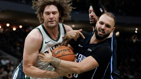 <p>               Milwaukee Bucks' Robin Lopez and Orlando Magic's Evan Fournier battle for a rebound during the second half of an NBA basketball game Saturday, Dec. 28, 2019, in Milwaukee. The Bucks won 111-100. (AP Photo/Morry Gash)             </p>
