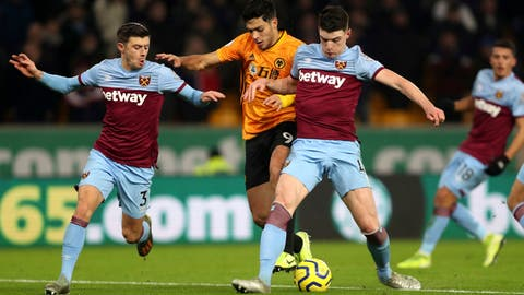 <p>               Wolverhampton Wanderers's Raul Jimenez, centre, challenges with West Ham United's Declan Rice, right, and Aaron Cresswell during their English Premier League soccer match at Molineux in Wolverhampton, England, Wednesday Dec. 4, 2019. (David Davies/PA via AP)             </p>