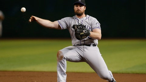 <p>               FILE - In this Monday, Aug. 19, 2019, file photo, Colorado Rockies first baseman Daniel Murphy makes a play for an out on a ball hit by Arizona Diamondbacks' Jarrod Dyson in the third inning during a baseball game in Phoenix. Colorado Rockies general manager Jeff Bridich says veteran first baseman Daniel Murphy may have rushed back too soon from a broken left index finger last season. (AP Photo/Rick Scuteri, File)             </p>