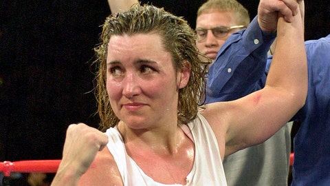 """<p>               FILE - In this March 3, 2001, file photo, Christy Martin looks toward her corner following her unanimous 10-round decision over Jeanne """"Boom Boom"""" Martinez, in Las Vegas. Martin was elected to the International Boxing Hall of Fame, Wednesday, Dec. 4, 2019. This was the first year that women were on the ballot. (AP Photo/Kevork Djansezian, File)             </p>"""