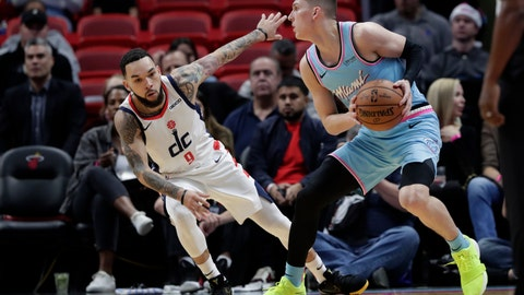 <p>               Miami Heat guard Tyler Herro, right, prepares to shoot as Washington Wizards guard Chris Chiozza (9) defends during the first half of an NBA basketball game, Friday, Dec. 6, 2019, in Miami. (AP Photo/Lynne Sladky)             </p>