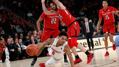 <p>               Louisville guard Lamarr Kimble (0) tries to pass after falling with Texas Tech forward TJ Holyfield (22) and Texas Tech guard Avery Benson (24) defending him during the first half of an NCAA college basketball game in the Jimmy V Classic, Tuesday, Dec. 10, 2019, in New York. (AP Photo/Kathy Willens)             </p>