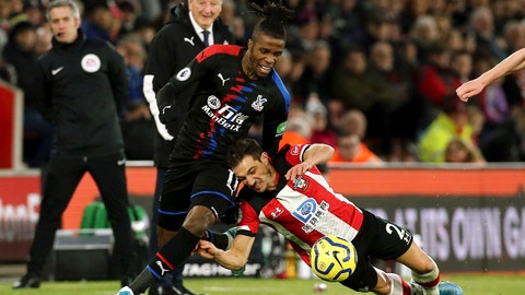 <p>               Crystal Palace's Wilfried Zaha, left, and Southampton's Cedric Soares battle for the ball during the English Premier League soccer match at St Mary's Stadium, Southampton, England, Saturday Dec. 28, 2019. (Mark Kerton/PA via AP)             </p>