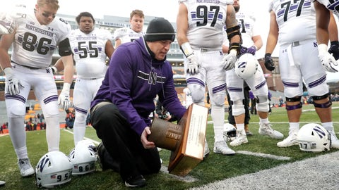 <p>               Northwestern head coach Pat Fitzgerald picks up the Land of Lincoln trophy after an NCAA college football game against Illinois, Saturday, Nov. 30, 2019, in Champaign, Ill. Northwestern won 29-10. (AP Photo/Charles Rex Arbogast)             </p>