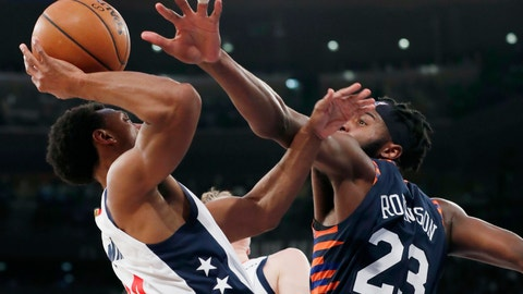 <p>               New York Knicks center Mitchell Robinson (23) defends against Washington Wizards guard Ish Smith (14) during the first half of an NBA basketball game in New York, Monday, Dec. 23, 2019. (AP Photo/Kathy Willens)             </p>