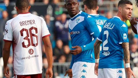 """<p>               FILE - In this Saturday, Nov. 9, 2019 filer, Brescia's Mario Balotelli, center, walks on the pitch during the Serie A soccer match between Brescia and Torino at the Mario Rigamonti Stadium in Brescia, Italy. Three leaders of the extreme-right Forza Nuova political party have been stopped by police for putting up a racist banner aimed at Brescia striker Mario Balotelli. The banner, which read """"Mario you're right, you're an African,"""" was posted on a fence outside Juventus' Allianz Stadium in Turin last month. The words """"Mario"""" and """"African"""" were written in red with the other words in black. The banner also featured a logo for the neo-fascist Forza Nuova party. (Filippo Venezia/ANSA via AP, File)             </p>"""