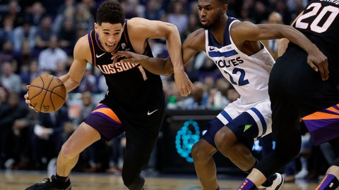 <p>               Phoenix Suns guard Devin Booker (1) drives around Minnesota Timberwolves forward Andrew Wiggins (22) during the second half of an NBA basketball game, Monday, Dec. 9, 2019, in Phoenix. (AP Photo/Matt York)             </p>