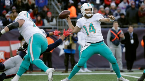 <p>               Miami Dolphins quarterback Ryan Fitzpatrick passes under pressure in the first half of an NFL football game against the New England Patriots, Sunday, Dec. 29, 2019, in Foxborough, Mass. (AP Photo/Elise Amendola)             </p>