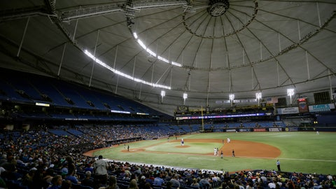 """<p>               File-This Aug. 29, 2017, file photo shows the Houston Astros playing the Texas Rangers during the third inning of a baseball game at Tropicana Field in St. Petersburg, Fla. The mayor of St. Petersburg says the city will not allow the Tampa Bay Rays to pursue a plan to split home games between new stadiums that would be built in Florida and Montreal. Mayor Rick Kriseman informed the City Council in a memo Wednesday, Dec. 4, 2019, that he and the team agree that the """"best path forward"""" is to abide by an existing contract that requires the Rays to play at Tropicana Field through 2027. (AP Photo/Chris O'Meara, File)             </p>"""